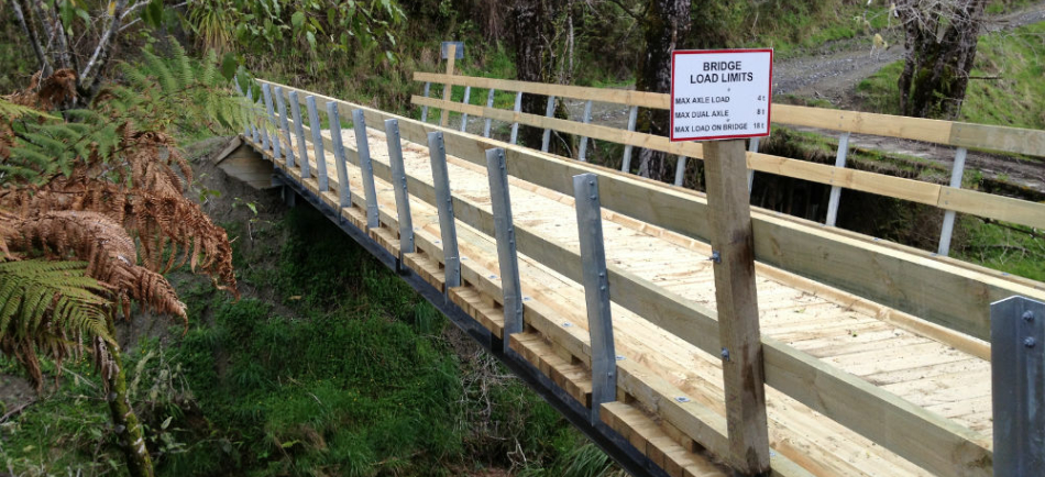 Steel beam timber deck bridge