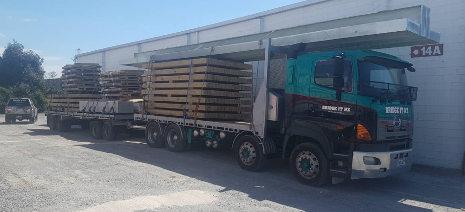 The truck loaded with bridge sections