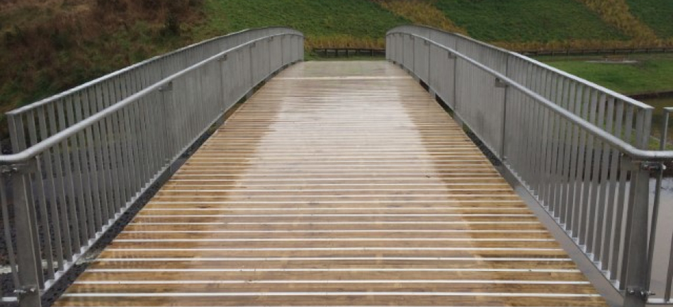 Lightweight timber deck steel beam pedestrian bridge