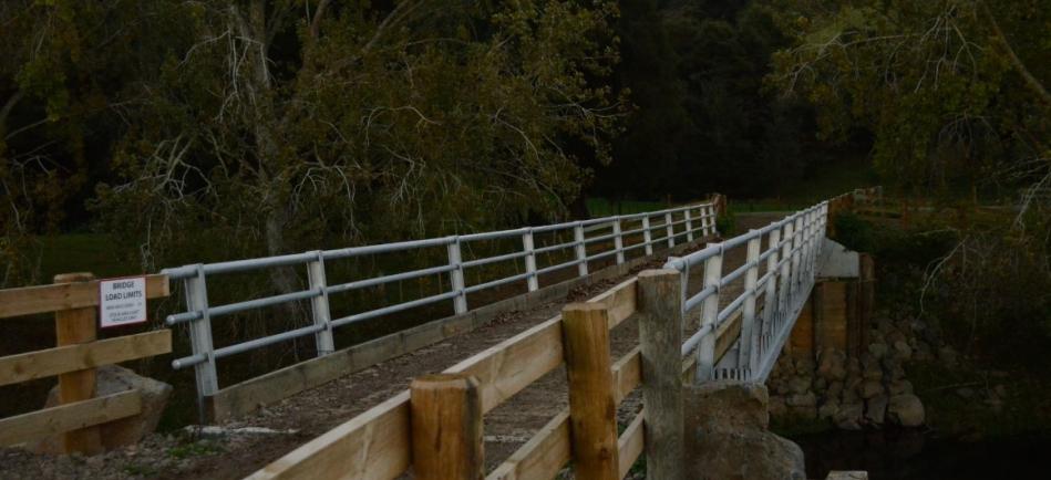 The deck of a heavy weight timber deck steel beam bridge