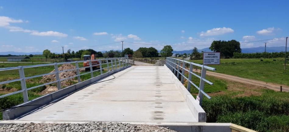 Steel beam, concrete deck farm bridge