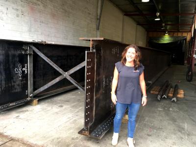 Diana McIntrye of Bridge It NZ with steel beams for the bridge